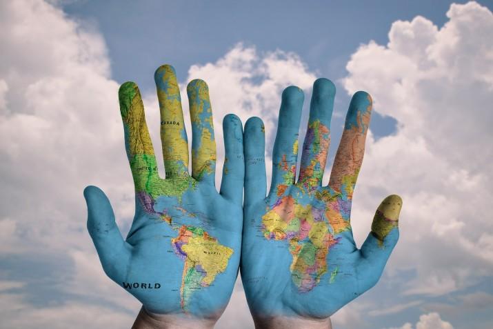 Hands and world map
